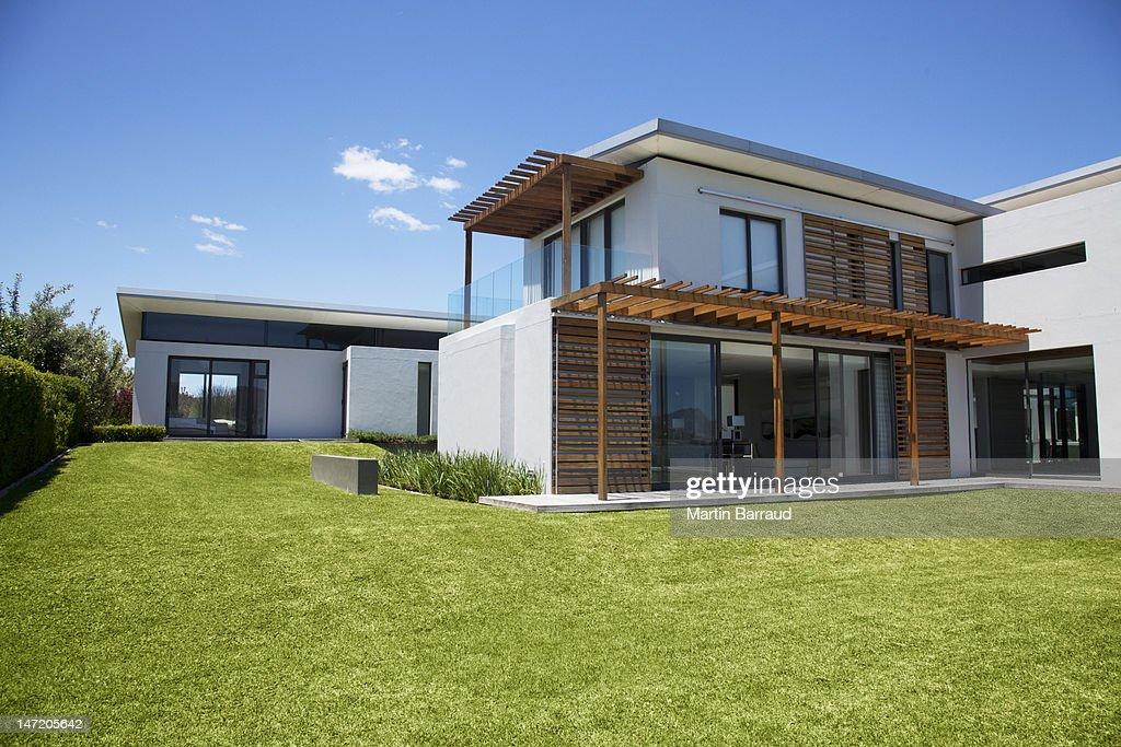 Modern house and yard : Stock Photo