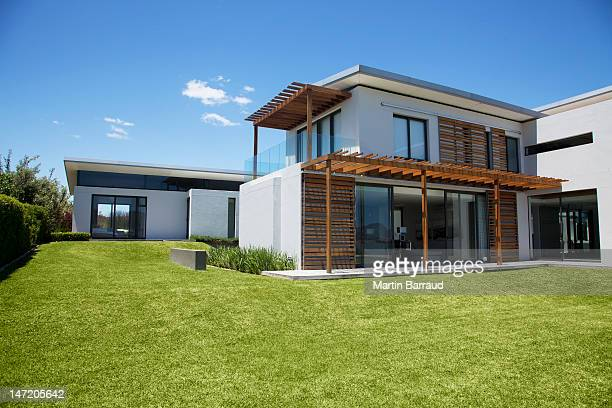 modern house and yard - buildings stock pictures, royalty-free photos & images