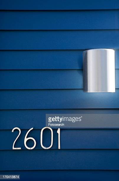 Modern House Numbers and Light on Blue Siding