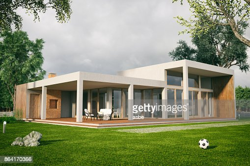Modern House With Large Patio And Swimming Pool Stock Photo | Getty ...