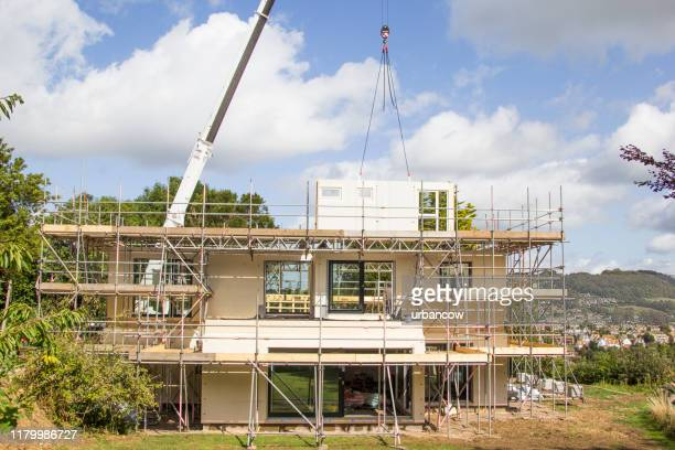 modern house under construction - construction industry stock pictures, royalty-free photos & images