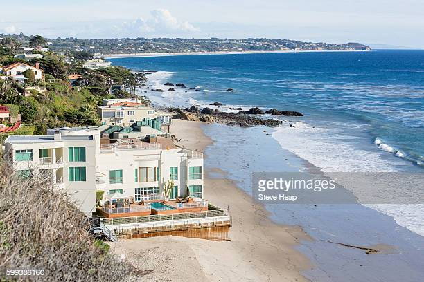 modern houses overhang ocean on el matador state beach in malibu, california, usa - malibu stock pictures, royalty-free photos & images