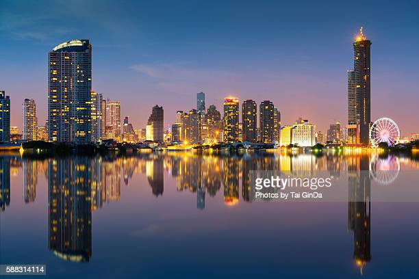 modern illuminated buildings and chao phraya river - bangkok stock pictures, royalty-free photos & images
