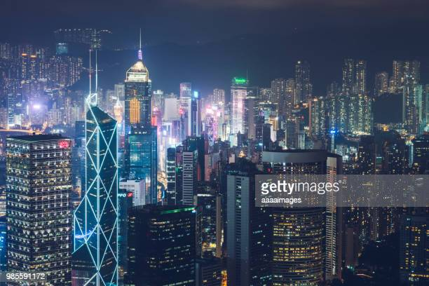 modern illuminated buildings in hong kong - kowloon peninsula stock pictures, royalty-free photos & images