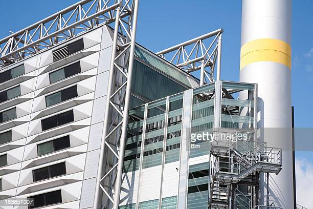 modern industrial building against blue sky - incinerator stock photos and pictures