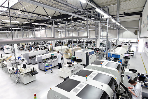 modern industrial factory for the production of electronic components - machinery, interior and equipment of the production hall 1150892960