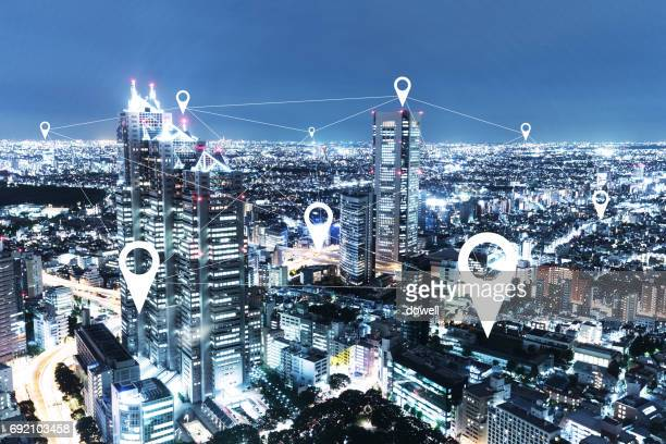 modern intelligence buildings in midtown of tokyo at night - gps map stock photos and pictures