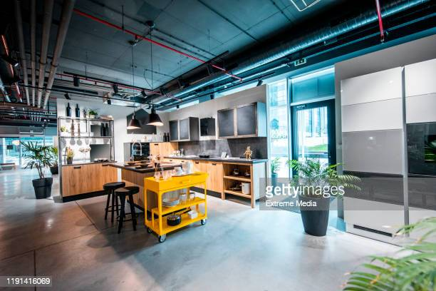 a modern interior kitchen design set up in a home improvement store - showroom stock pictures, royalty-free photos & images
