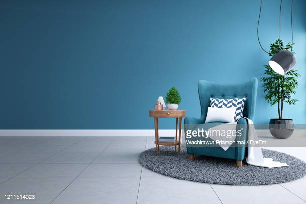 modern interior of living room,blueprint home decor concept ,blue sofa and black lamp - indoors stock pictures, royalty-free photos & images