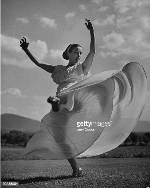 Modern interpretive dancer Martha Graham executing one of her famous swirling turns
