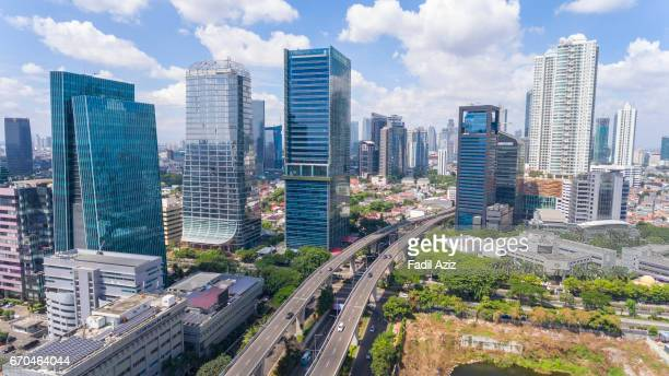 modern jakarta and its new highway, aerial view - jakarta stock pictures, royalty-free photos & images