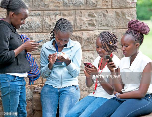 modern kenyan girls with mobile, nairobi, kenya, africa - nairobi stock pictures, royalty-free photos & images