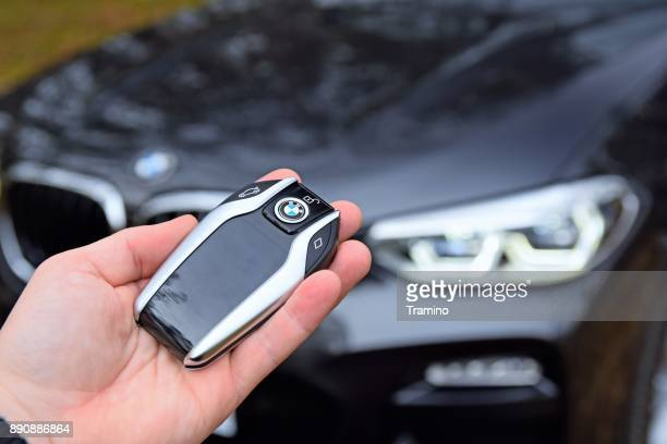 modern key to the bmw in a hand - bmw stock pictures, royalty-free photos & images