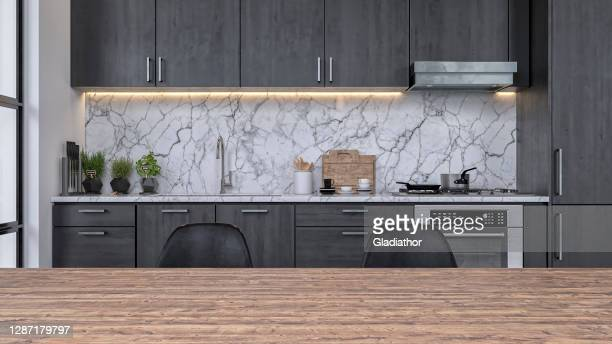 modern kitchen and dining room - focus on background - kitchen worktop stock pictures, royalty-free photos & images
