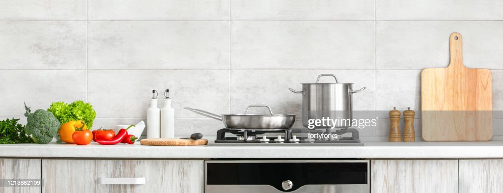 Modern kitchen countertop with domestic culinary utensils on it, home healthy cooking concept banner : Stock Photo