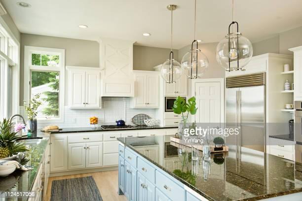 modern kitchen design with open concept and bar counter - household equipment stock pictures, royalty-free photos & images