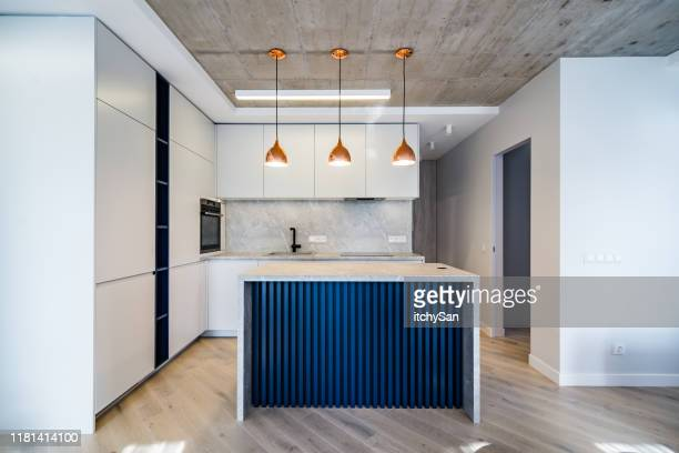 modern kitchen front view - wide shot stock pictures, royalty-free photos & images