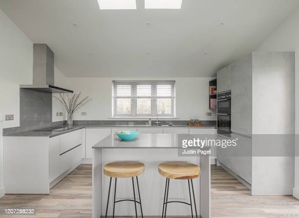 modern kitchen in show home - kitchen stock pictures, royalty-free photos & images