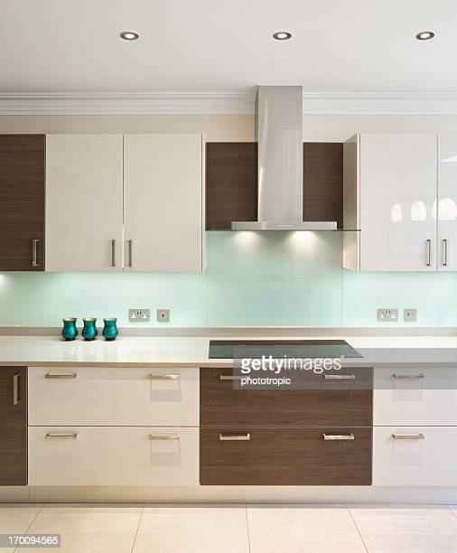 Modern kitchen in walnut and cream