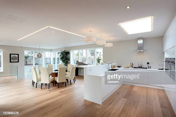 Modern kitchen in white with a hardwood floor