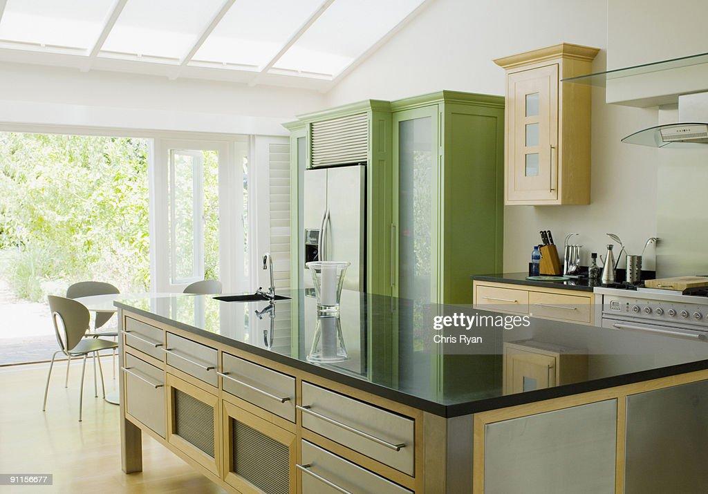 Modern kitchen island in kitchen : Stock Photo