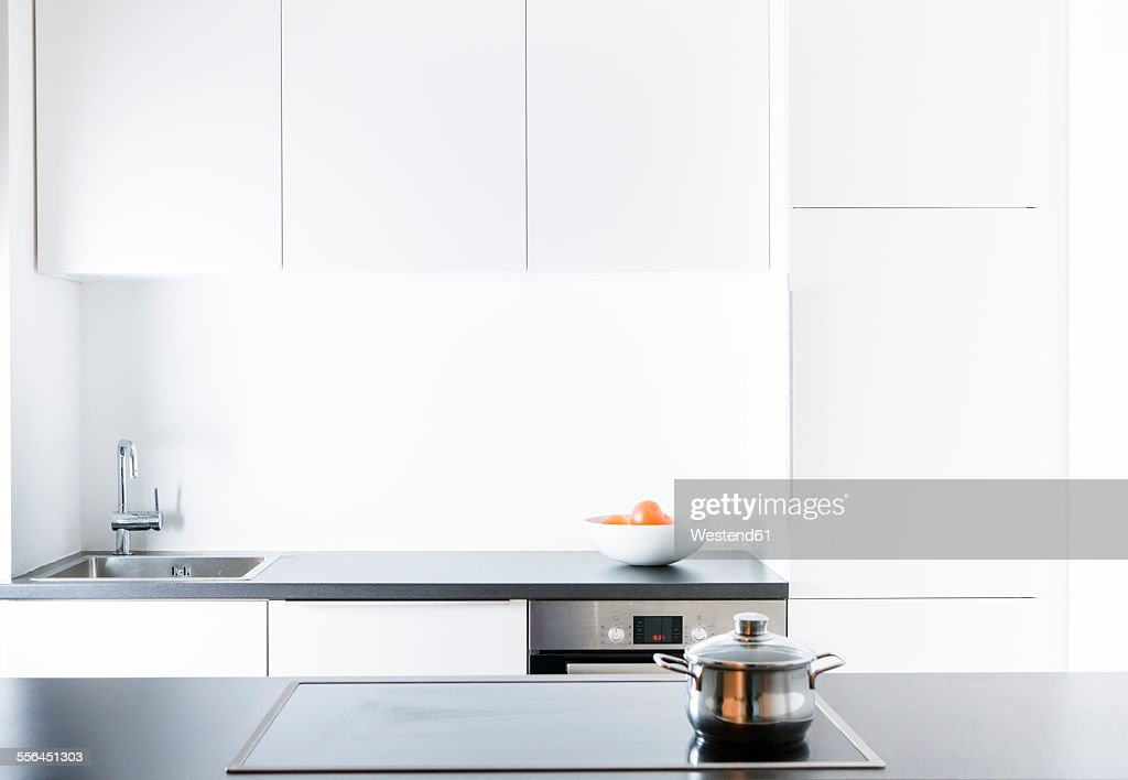 Modern kitchen, pot on cooker : Stock Photo