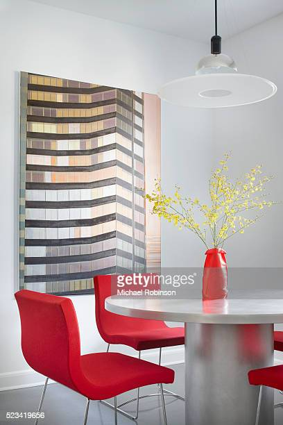 Modern Kitchen Table in Chicago with High Rise artwork in the Background.