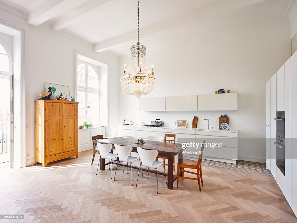 Modern kitchen with dining table in a refurbished old building : Stock Photo