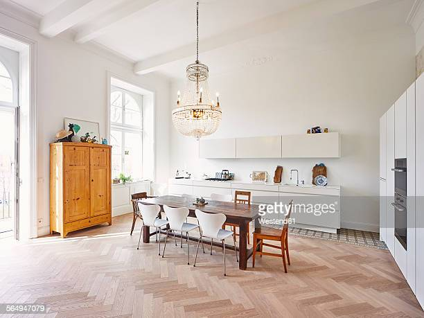 modern kitchen with dining table in a refurbished old building - wohnung stock-fotos und bilder
