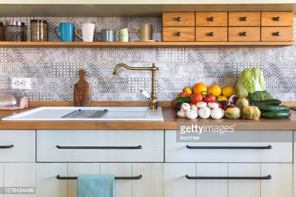 modern kitchen with fresh vegetable - kitchen sink stock pictures, royalty-free photos & images