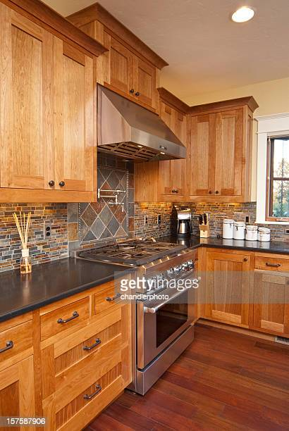 Modern kitchen with hardwood floors & stainless steel stove