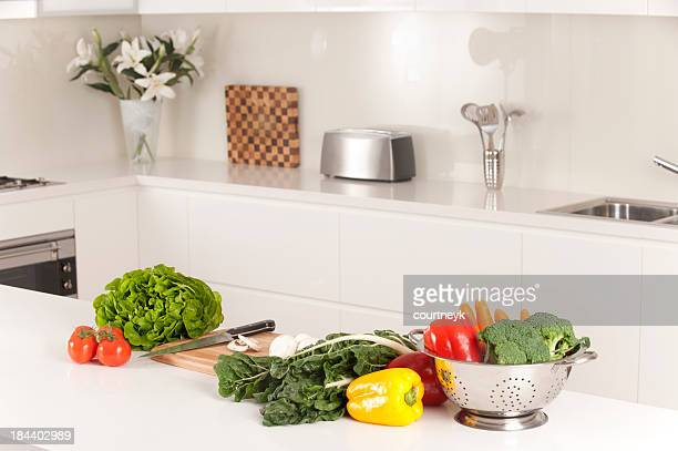 Modern kitchen with healthy vegetables
