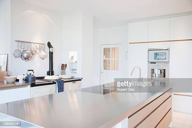 modern kitchen with stainless steel counters - kitchen stock pictures, royalty-free photos & images