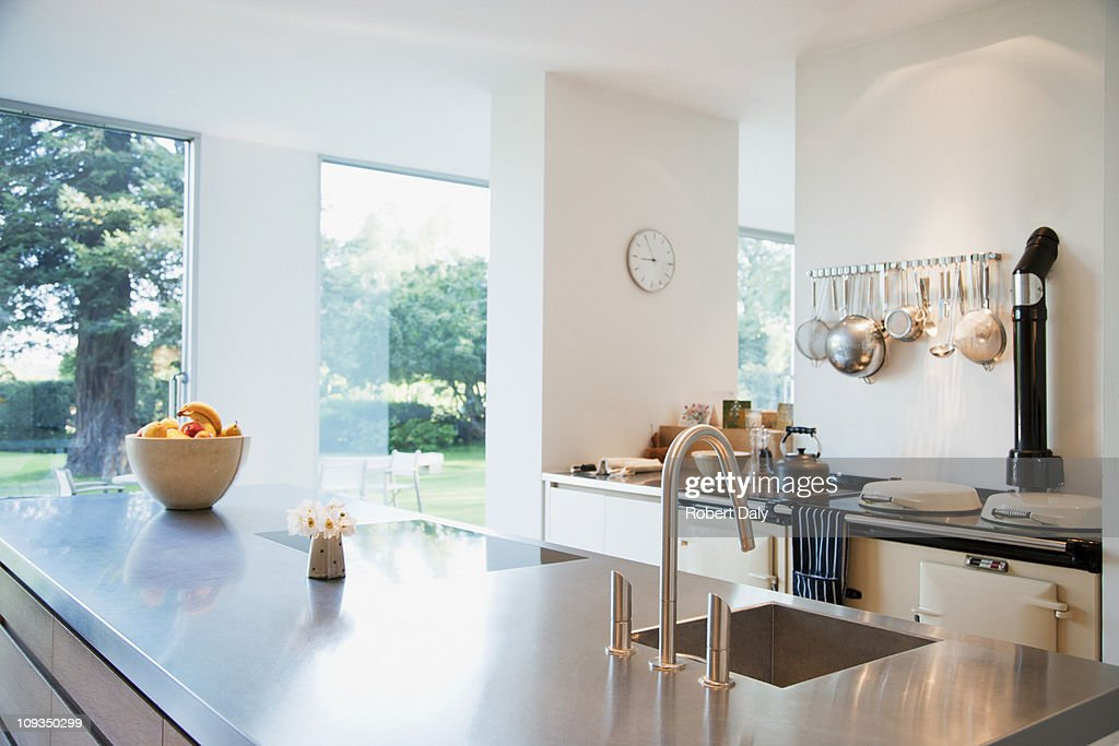 Modern kitchen with stainless steel counters : Stock Photo