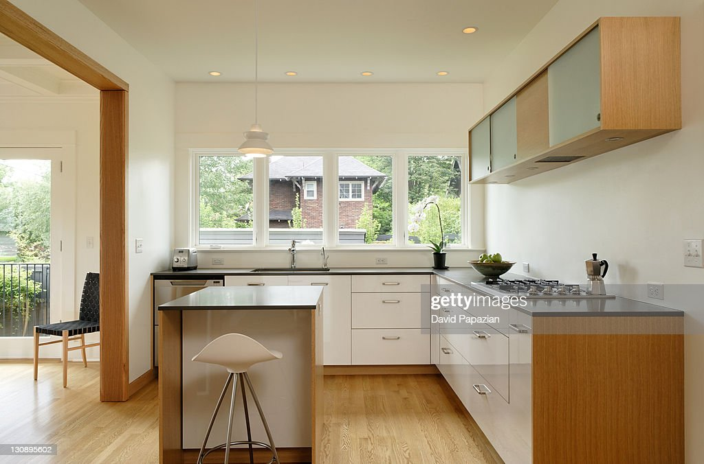 Modern kitchen with wood trim : Stock Photo