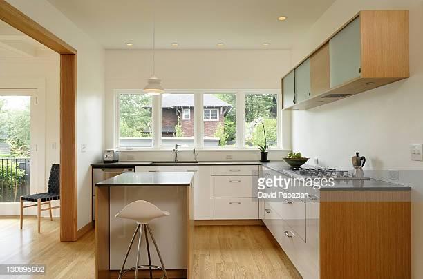 Modern kitchen with wood trim
