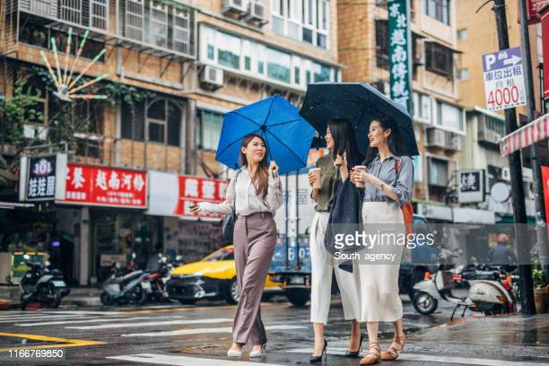 modern ladies walking the streets of taipei - taiwan stock pictures, royalty-free photos & images