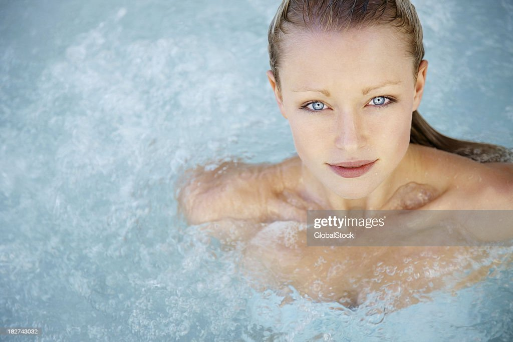 Modern life - Pretty young woman in a hot tub : Stock Photo