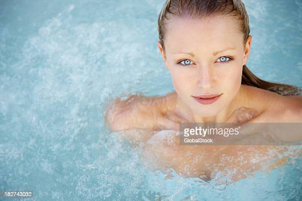 Modern life - Pretty young woman in a hot tub