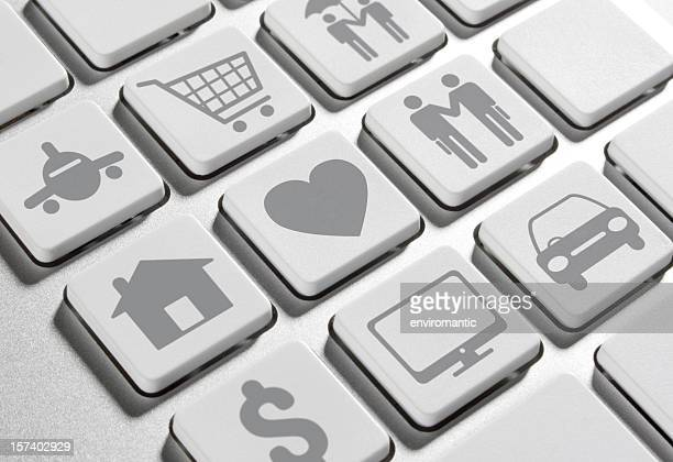 Modern lifestyle icons on a computer keypad.