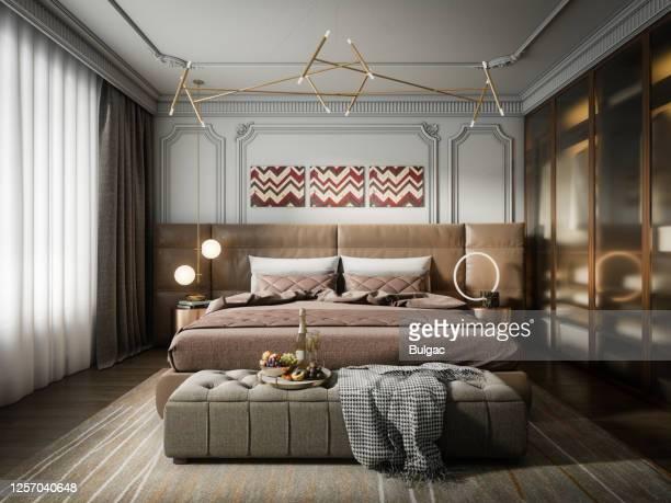 chambre de luxe moderne de lumière - grand lit photos et images de collection