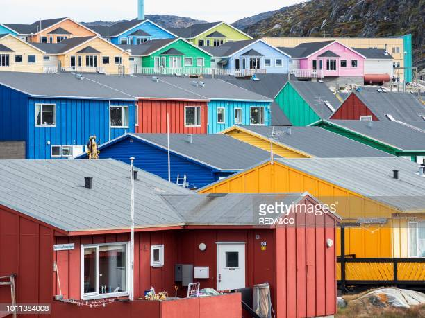 Modern living quarter with colorful houses Town Ilulissat at the shore of Disko Bay in West Greenland center for tourism administration and economy...