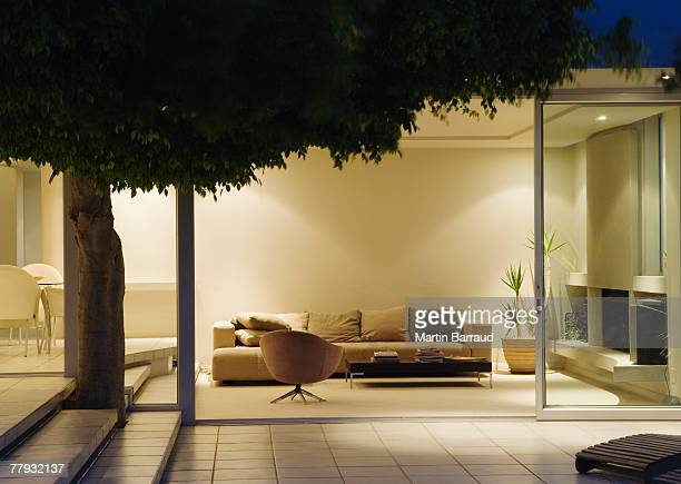 Modern living room and patio with sliding glass walls