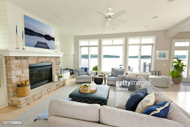 modern living room home interior design with fireplace and television - waterfront stock pictures, royalty-free photos & images