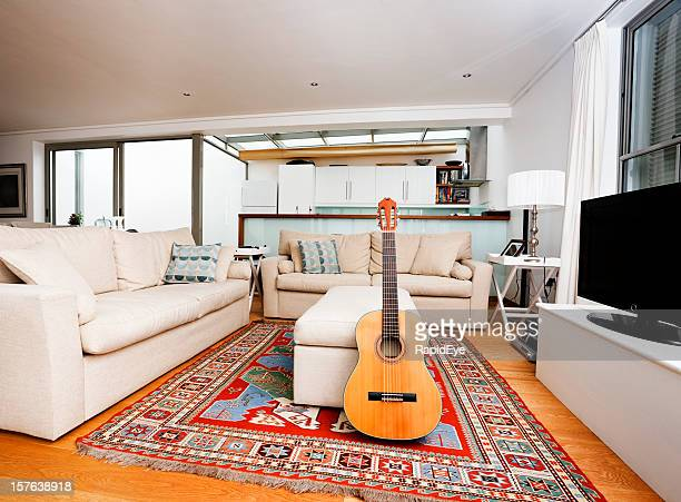 Modern living room interior with classic acoustic guitar