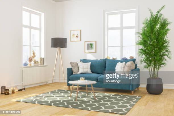 modern living room interior with comfortable sofa - neat stock pictures, royalty-free photos & images