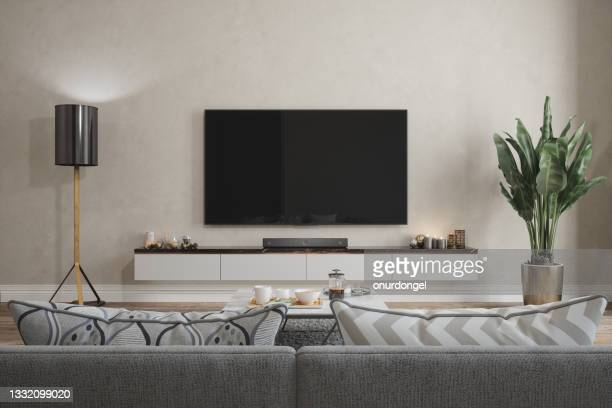 modern living room interior with smart tv, sofa, floor lamp and potted plant - television stock pictures, royalty-free photos & images