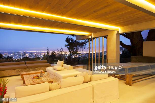 Modern living room overlooking illuminated cityscape at night