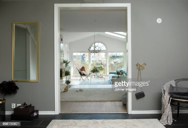 modern living room - doorway stock pictures, royalty-free photos & images