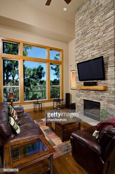 Modern living room set with brick wall and fireplace